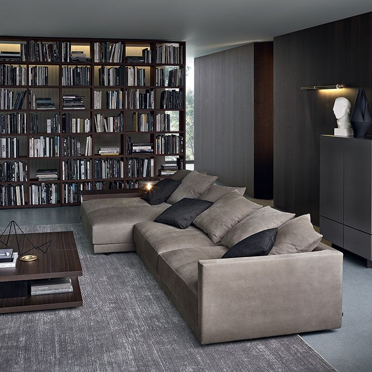 Poliform_Bristol composition with chaise-longue, in nubuck leather. Central and lateral coffee table in spessart oak, piombo painted metal feet. Ipanema armchairs in spessart oak and seat cushions in removable fabric. Visone mat lacquered Pandora sideboard. Wall System bookcase in spessart oak.