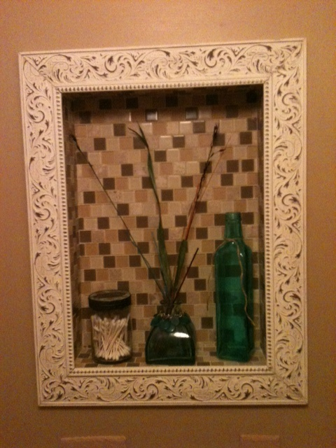 This was an old medicine cabinet in the wall with an ugly door, I took it out and added tile and a frame for an inset shadow box in my bathroom.