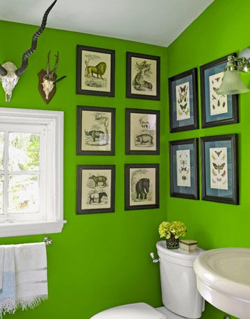Green Bathroom    I love the bright green with black and white vintage prints....great combo!
