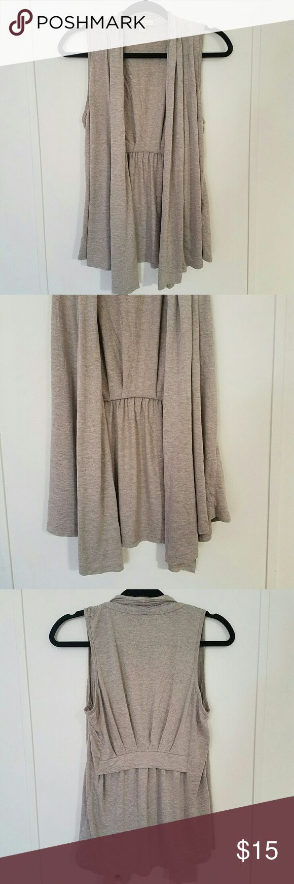 F21 Drape Front Sleeveless Cardigan Forever 21 sleeveless drape front cardigan.  Light gray.  Super soft and versatile!  Cute design on back.  Only worn once or twice!  Excellent, like new condition!  Size Medium, but can fit small too! Forever 21 Sweaters Cardigans
