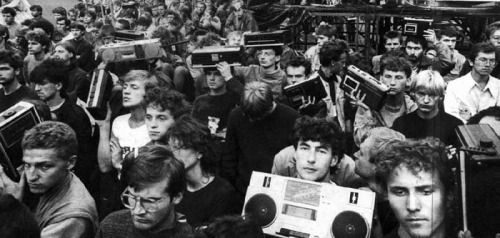 "Polish youth bringing their boomboxes to the Jarocin Festival in order to record their favorite bands, as a way of circumventing the censorship and the authorities strict policies on the publishing of ""Western-style"" music, Poland (mid 1980s)"