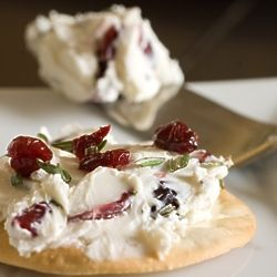 Thanksgiving appetizer! Cranberry, rosemary and cream cheese spread.