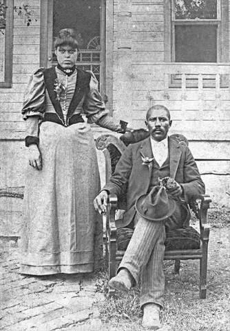 """Junius George Groves was born in slavery, in 1859, in Louisville, KY. He came to Kansas as an Exoduster, purchasing 80 acres of land raise white potatoes and becamd known as the """"Potato King of the World."""" In the early 1900s, he founded the community of Groves Center, near Edwardsville. He built a golf course for African Americans, possibly the first such course in the county. At the height of his success he owned more than 500 acres. Junius Groves and Wife, Matilda E., ca. 1895."""