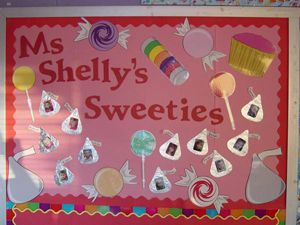 """"""" ____'s Sweeties"""" is a sweet idea for a Valentine's Day bulletin board display.  This teacher glued photographs of her students inside Hershey's kisses shapes."""