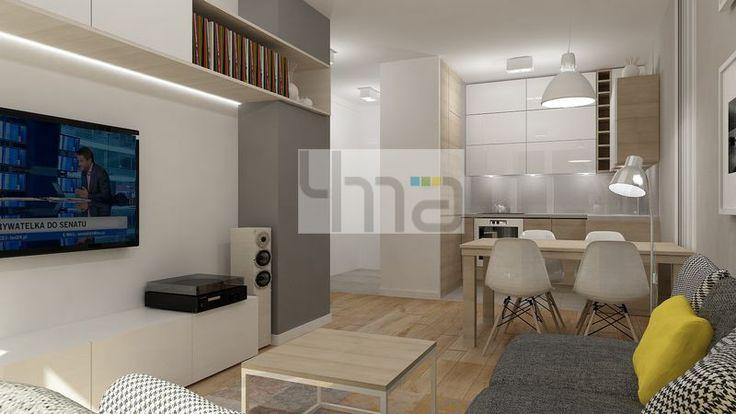 Dwupokojowe mieszkanie 48 m2 zaprojektowane dla młodej pary - http://4ma-projekt.pl Biało-szara kolorystyka z elementami jasnego drewna. Jadalnia, salon, kuchnia.
