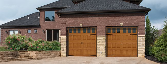 Fiberglass Garage Door Model 981 | Impression Collection® | This door features a classic vertical raised panel design with an oak wood grain pattern. | Learn more at overheaddoor.com