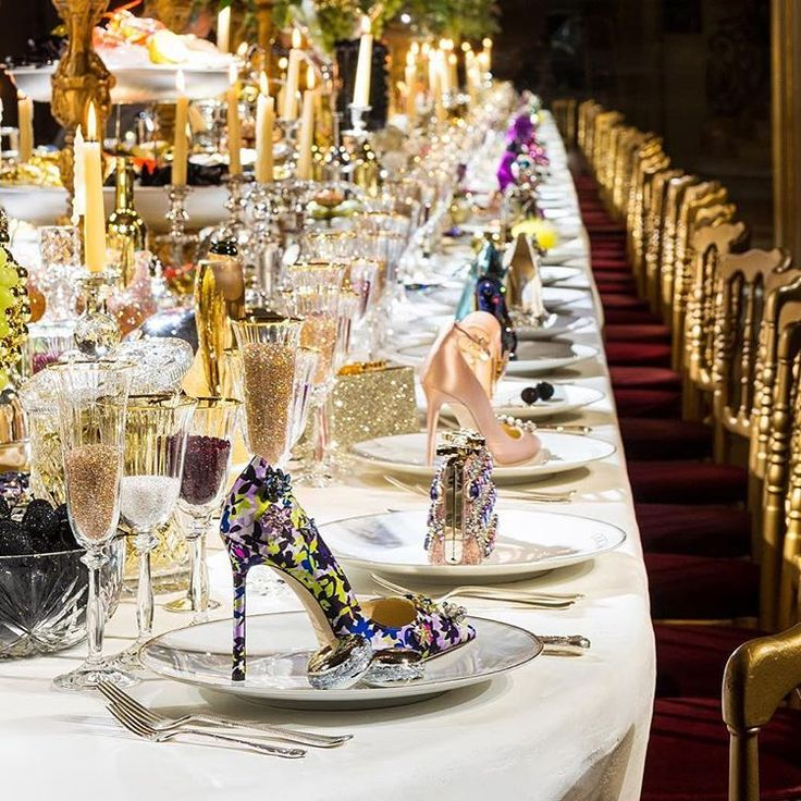 Hello #TuesdayShoesday! Can you imagine a more perfect #placesetting than one filled with Jimmy Choo #heels and accessories? | WedLuxe Magazine | #wedding #luxury #weddinginspiration #shoes #eventdesign