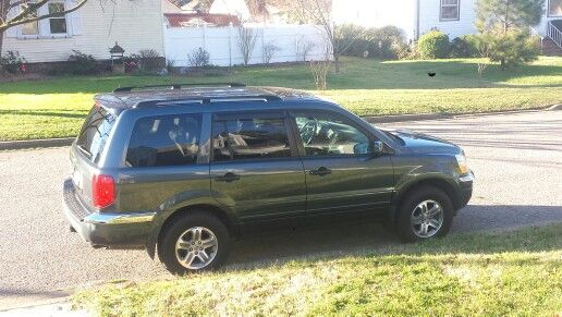 2005 Honda Pilot exl As of Jan. 13, 2016 After market tow package Chrome fender pieces