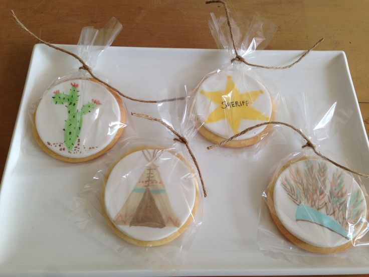 Hand painted cowboys and Indians themed cookie favours