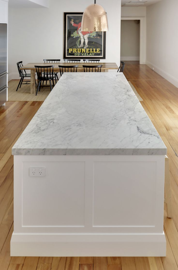 Carrara marble island with shaker detailing and high skirting to ends