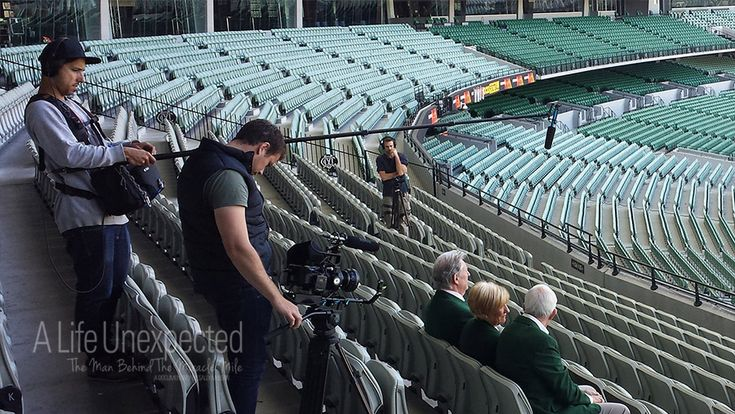 Tim McCormick, Shaun Herbertson and Ben Steel filming at the MCG. Photo by Sally McLean