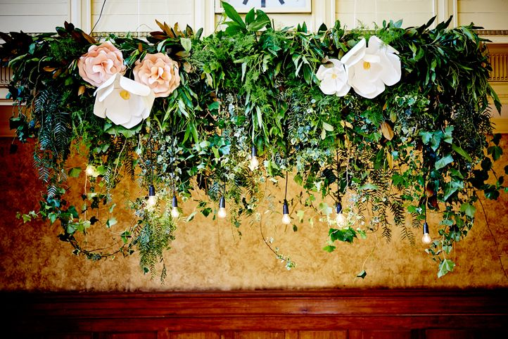 LETTUCE & CO - STYLE. EAT. PLAY 'viv + lachy - modern art deco'. hanging floral installation. foliage with giant paper flowers. giant paper magnolia. black festoon dropper pendant lighting. wedding reception @ northcote town hall. concept, design and wedding styling by lettuce & co