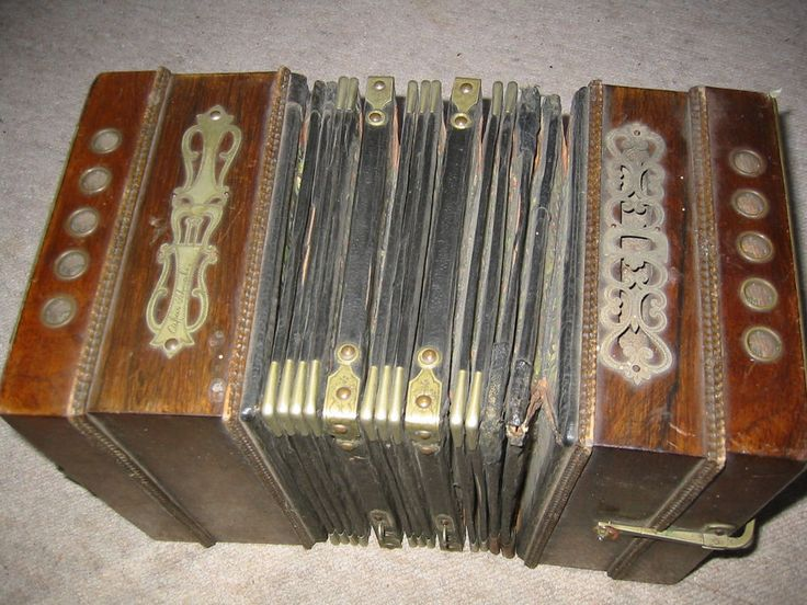 """Interestin and old concertina or bandoneon?. It Reads """"Oskar Schwabe"""" The size of the body is 12 ; 7,5 ; 8 1/4'. (30 /19/21cm). The instrument needs serious repair, service and cleaning. it is diatonic. 