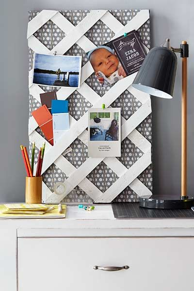 Make a memento board: Cut a piece of plywood to size and cover it with batting and fabric. Secure with a staple gun. Tack a piece of lattice on top with brad nails. Tuck paint swatches and the like into the openings.