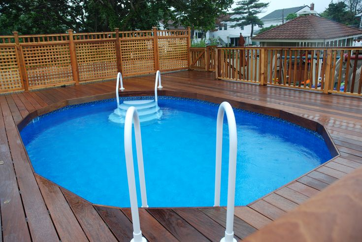 Ipe 39 decking with cedar privacy lattice around above for Above ground pool privacy ideas
