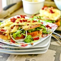 The standard egg-on-toast breakfast gets kicked up with pancetta, arugula, sun-dried tomatoes and hollandaise sauce.