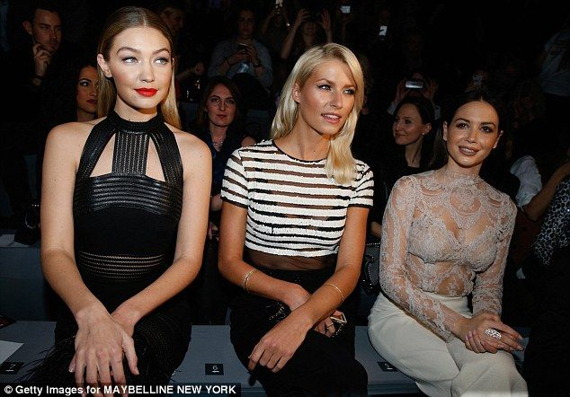 Prime position: Gigi took her place in the front row alongside Lena Gercke and Mandy Capristo, and the trio sat elegantly as they watched the models do their thing