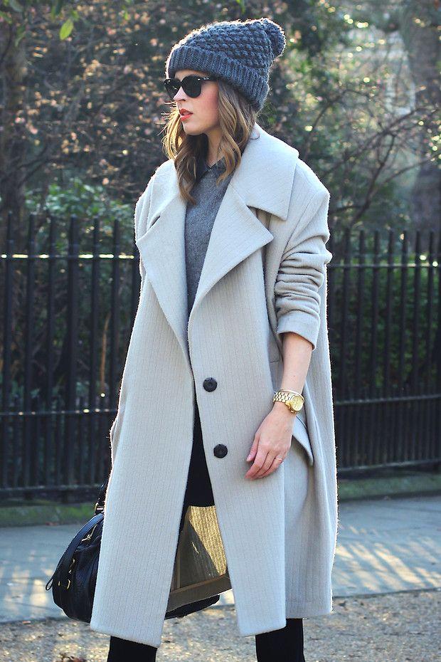 Grey coat. Grey beanie.