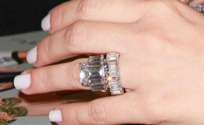 Kim Kardashian S 20 5 Carat Engagement Ring With An Equally Enormous 12 Carat Band From He Kim Kardashian Engagement Ring Beautiful Engagement Rings Engagement