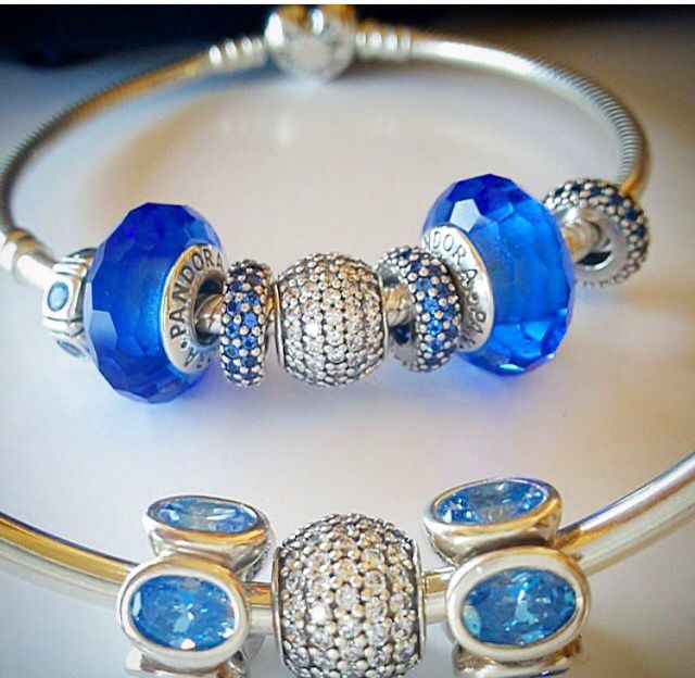 Munaro glass charms in sky blue with other sparkly blue and white  highlights on a Pandora Bangle.