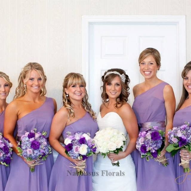 Purple wedding flowers along the purple bridesmaids dresses are perfection!  Narcissus Florals, Toms River, NJ. www.mynarcissus.com   732-281-0333