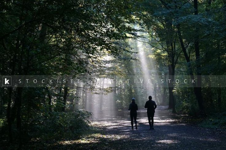 An enchanting Eden for joggers in a dark forest. By Axel Bueckert.  Stockiste.com  Creative stock + Exclusivity on the GO!   Direct Link: https://www.stockiste.com/display/jogging-couple-silhouetted-against-sunbeam-in-dark-forest/12389  #Stockiste, #StockisteCreativeStock, #Stockphoto, #Stockimage, #Photographer, #AxelBueckert, #ContentMarketing, #Marketing, #Storytelling, #Creative, #Communications, #Jogging, #Couple, #Forest, #Sunbeam,   jogging couple silhouetted against sunbeam in dark…