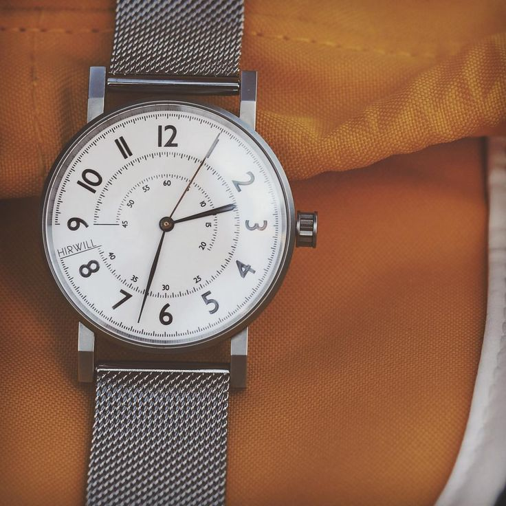Hirwill Watches. Stainless steel case. White enamel dial. Steel mesh strap.