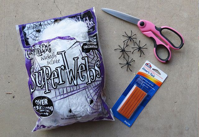Supplies for hanging fake spider webs.