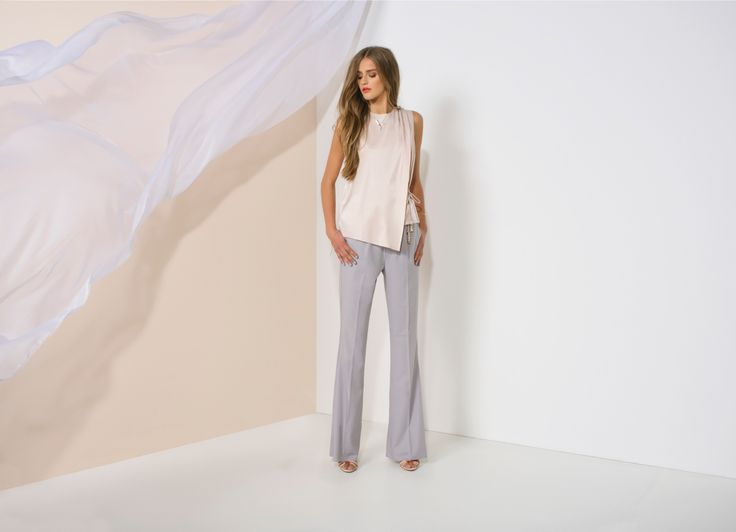 https://joshv.com/kleding-joshv/collectie/seventeen-joshv-17 Wear your summer shine all day! The JOSH V Vivi top has a chic look due to the luxurious shiny material used. This sleeveless top has an asymmetrical overlay and a cord to create an optically slim waist. Wear the JOSH V Vivi top on an elegant flared Kellie Pants to complete the office chic look. #JOSHV #Highsummer #Summer #Lookbook #Trousers #Top #Heels #Outfit