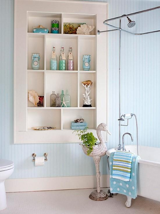 between studs shelving bathroom - the molding makes it look elegant