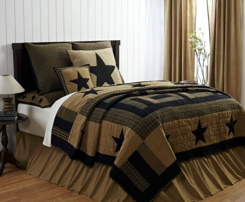 beautiful black and tan quilt with stars goes great with primitive or rustic bedroom decor