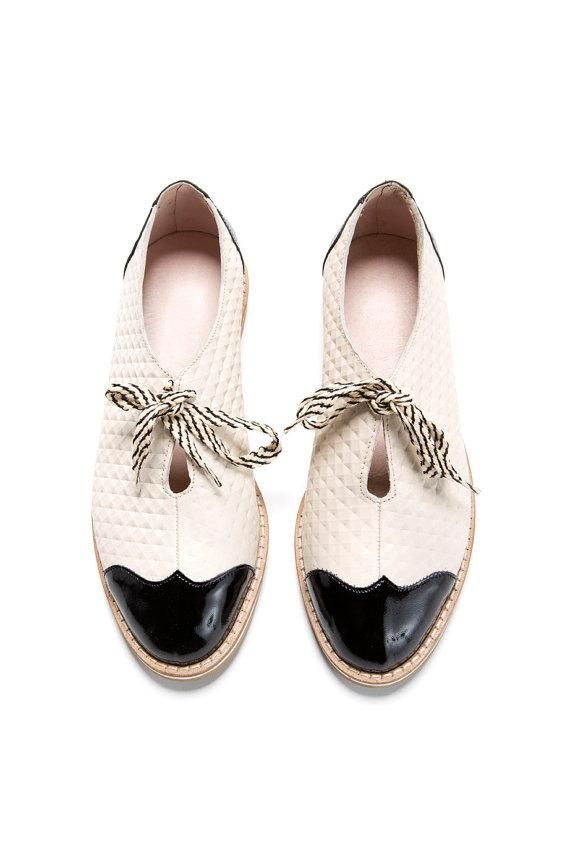 We love the subtle pattern and contrasting tips on these handmade leather oxfords, crafted in Tel Aviv. (Plus don't those shoelaces really, ahem, tie the whole thing together?) #etsy