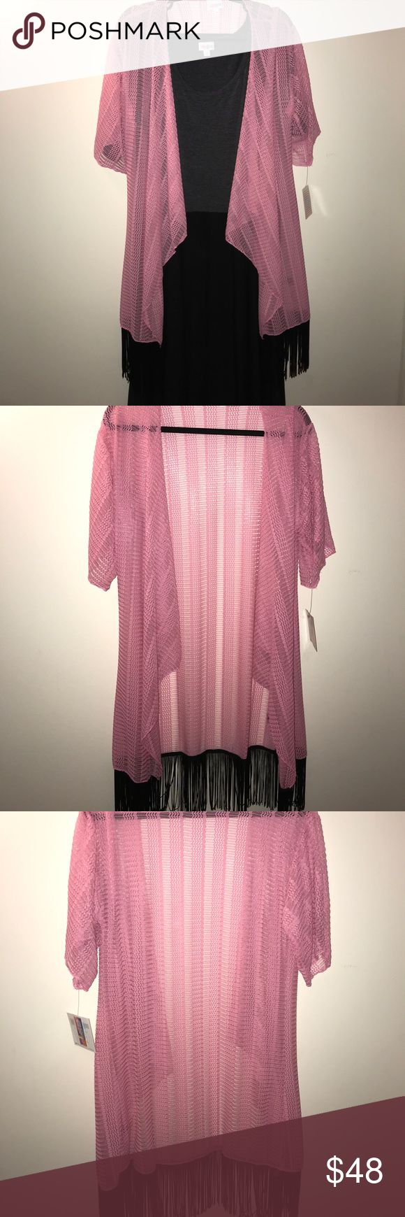 Beautiful Small LuLaRoe Monroe This is not your typical Monroe!! Instead of your chiffon non stretchy material this is nylon/spandex mix that stretches!! I normally can only fit the large Monroes but I can wear this with ease!!! It's a pretty pink pink with black fringe!! BNWT (Dress not included) LuLaRoe Other