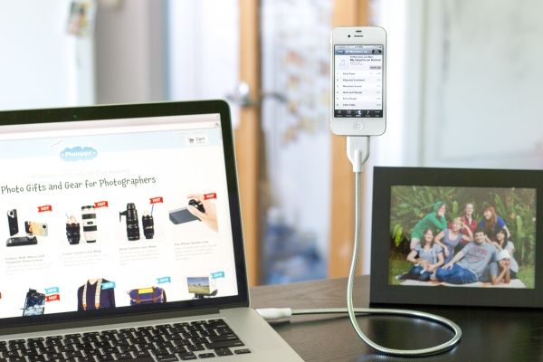 Coiled charging cable for iPhone and iPod Touch that doubles as a stand or a tripod.