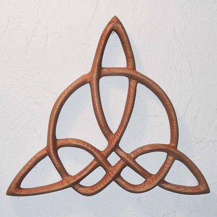 "Triquetra of Harmony-Celtic Wood Carved Knot              MEANING: When you are struggling to find balance with different aspects of your life, this symbol may call to you.    One definition of Harmony is, ""The just adaptation of parts to each other in a system or combination of things intended to form a connected whole to produce unity.""     This is a variation of the original Triquetra Knot that represents the Aspects of the ancient Celtic Goddess or the Christian Holy Trinity. In the…"