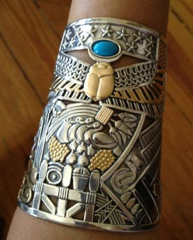 Cuff | Azza Fahmy.  Silver, gold and turquoise stone.  Egyptian influences towards thick, gold Jewellery