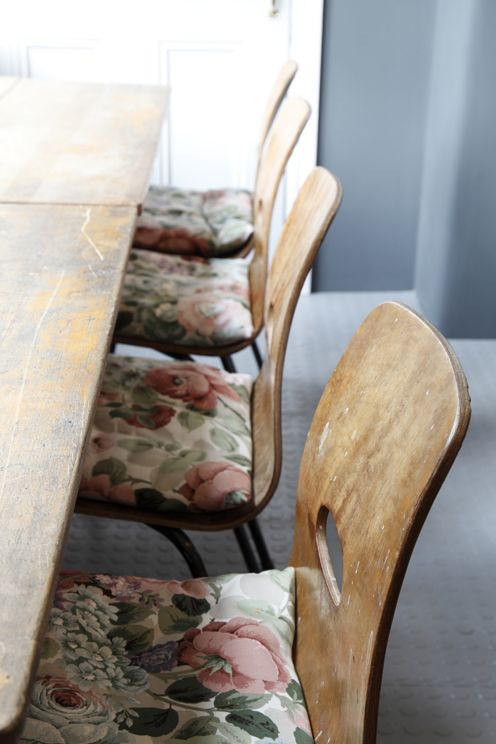 Worn Wood Chairs With Vintage Floral Seat Pillows
