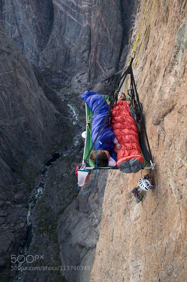 A man and woman sleep on portaledge while rock climbing a vertical face in Gunnison Colorado. by outdoor_photos. Please Like http://fb.me/go4photos and Follow @go4fotos Thank You. :-)