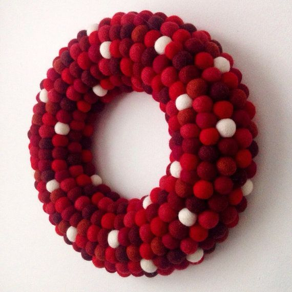 Brighten up your home with this gorgeous felt ball wreath in lush red hues with sprinkles of white. Perfect for adding a touch of cheerful delight to your home. Hang it on a door, a window, above a mantel piece or on the wall.  I make each wreath to order using between 300 - 400 felt balls averaging 3/4 inch (2cm) made from 100% beautiful felt wool. A hanger made from ribbon is attached to the back of the wreath so it can hang easily in any location. Size: you can choose from 2 different...
