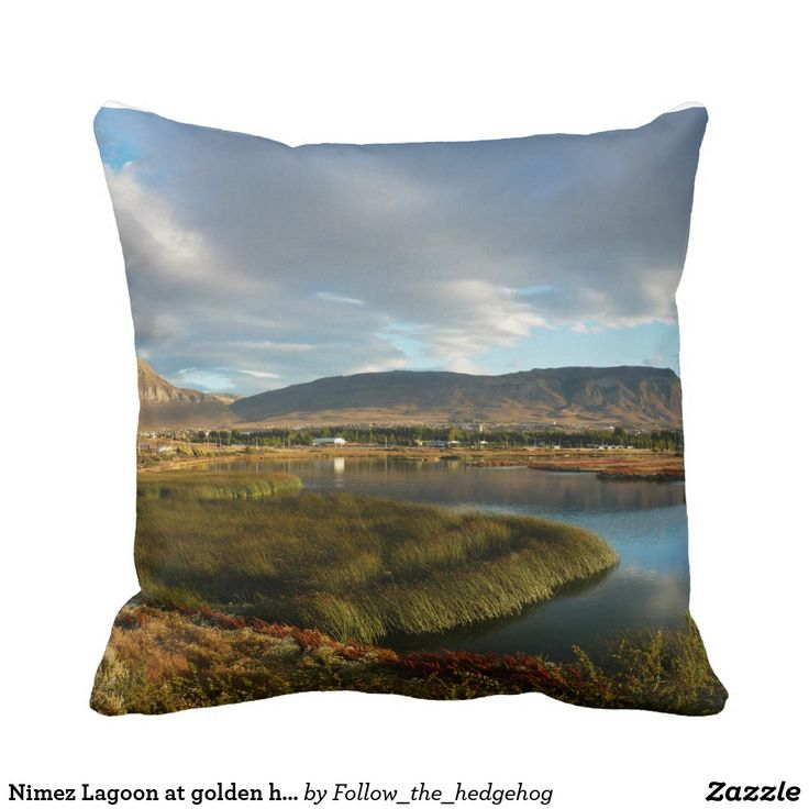 Nimez Lagoon at golden hour Throw Pillow Nimez Lagoon at golden hour The idyllic Nimez Lagoon at golden hour. Surrounded by reeds and topped by a cloudy sky. Remarkable reflection and precious light for this wide panorama. The picture was taken in El Calafate, Argentina