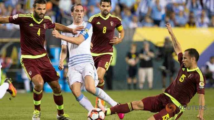 Uruguay 0 Venezuela 1 in 2016 in Philadelphia. Alejandro Guerra makes a good tackle in Group C at Copa America.