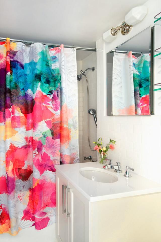 Try a perky shower curtain if you want to make a big statement. You can buy several of them and switch them as the mood strikes. In an otherwise boring, neutral bathroom, a splashy, perky shower curtain can also guide further color and accessory choices.