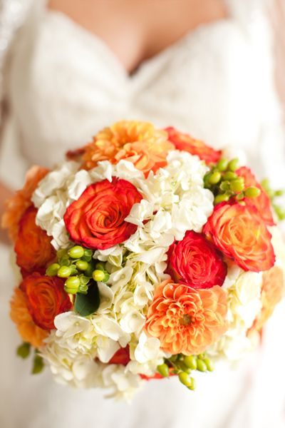 Orange wedding bouquet... Wedding ideas for brides, grooms, parents & planners ... https://itunes.apple.com/us/app/the-gold-wedding-planner/id498112599?ls=1=8  ... The Gold Wedding Planner iPhone App.