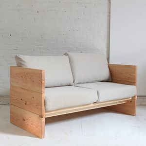 Check out this project  - This wood framed sofa made from 2x10s is simple and durable, with a timeless style, it can be built around almost any sofa cushions you might have or even a single mattress if you want it to double as a daybed. I salvaged some cushions from an Ikea sofa whose frame had broken. Pile pillows along the sturdy, solid-wood sides and back to make this a perfect daybed for a couple to lounge on.   Click here to download Homemade Modern's project plans for this How-To!