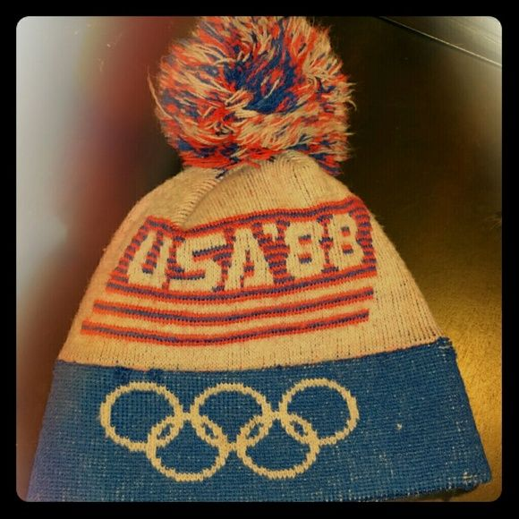 Vintage 1988 US Olympics beanie This cool piece of wearable Olympic history is perfect for the cold weather that is coming. The 1988 Winter Olympics, officially known as the XV Olympic Winter Games (French: Les XVes Jeux olympiques d'hiver), was a Winter Olympics, multi-sport event; celebrated in and around Calgary; Alberta, Canada between February 13 and 28, 1988. Features red, white, and blue on the hat with a pom on top. Says USA '88. Get this wearable icon now before it's gone…