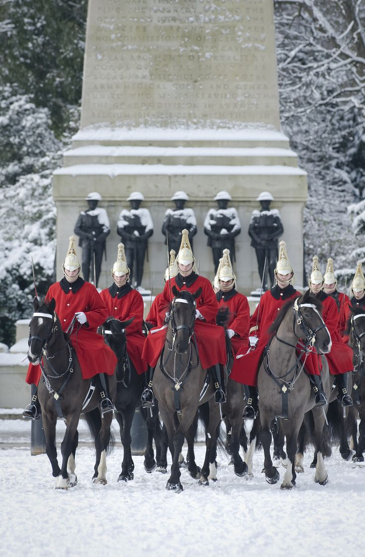 British Army feeling festive. The Life Guards riding on to Horse Guards Parade, in London, in the snow. Photographer Sergeant Adrian Harlen; Crown copyright.