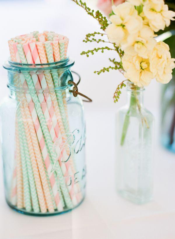 striped straws in blue mason vase