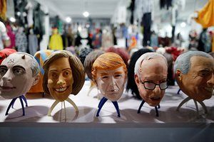 A finished mask of Trump sits amongst some of the others the factories produces, including Bernie Sanders and Vladimir Putin