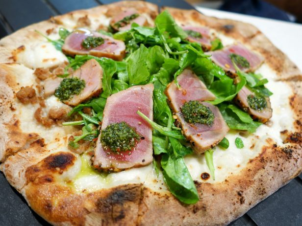 Pizza and Cocktails on the Waterfront: Maui Food: Pi Artisan Pizzeria : You can choose your dough, sauce and toppings, or opt for one of the tried-and-true signature pizzas, like the Seared Ahi Tataki or the Chicken Ranch. The cocktails draw a lively happy hour crowd thirsty for drinks like the Blue Lavender Fizz, which uses blueberries and local...