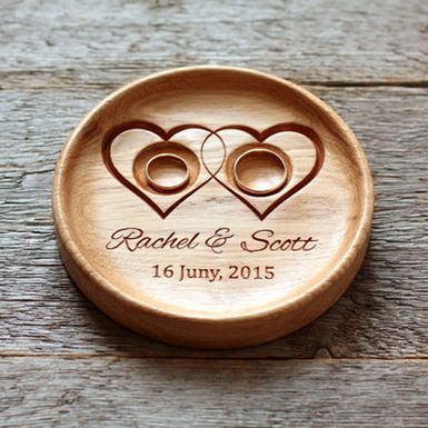 Handmade custom wood wedding ring holder, made of beeswax and oak wood, with names and wedding date engraved.